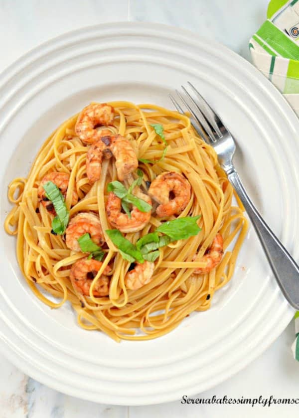 Shrimp Scampi with Linguine Pasta in a white wine sauce on a plate is an easy recipe from Serena Bakes Simply From Scratch.