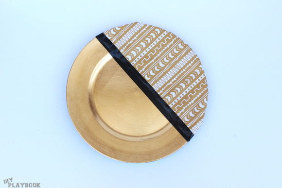 All you need for this decorative plate project is some painters tape and spray paint
