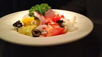 Garnished Greek salad in serving plate