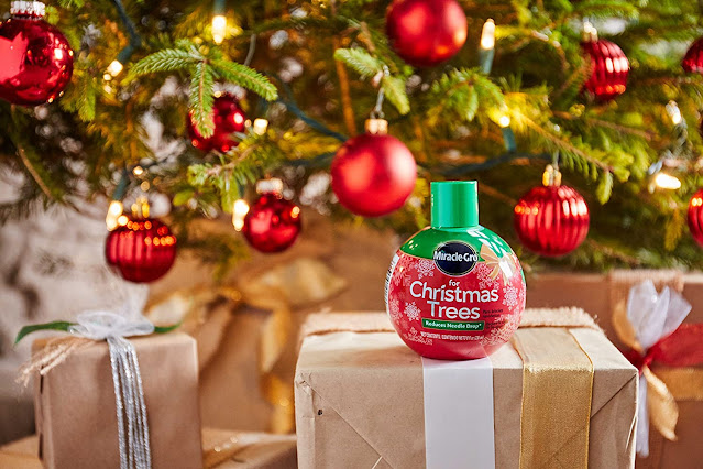 Miracle-Gro Christmas Tree Plant Food Christmas tree red ball ornaments brown gift boxes