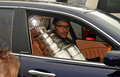 Dustin Byfuglien driving car with a trophy