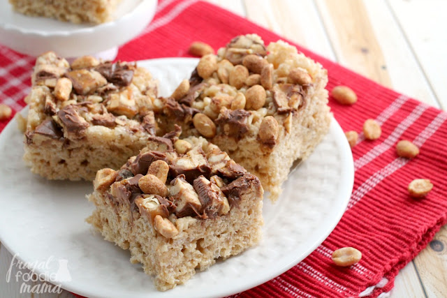A classic no-bake treat gets jazzed up with the addition of creamy peanut butter, Snickers, & honey roasted peanuts in these Snickers Peanut Butter Rice Krispies Treats.