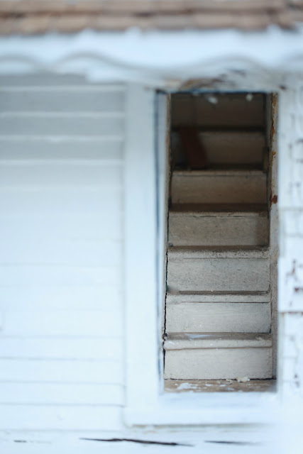 old stairs in a vintage dollhouse.