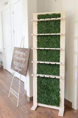 At Last Wedding Studio hedge wall champagne holder rental