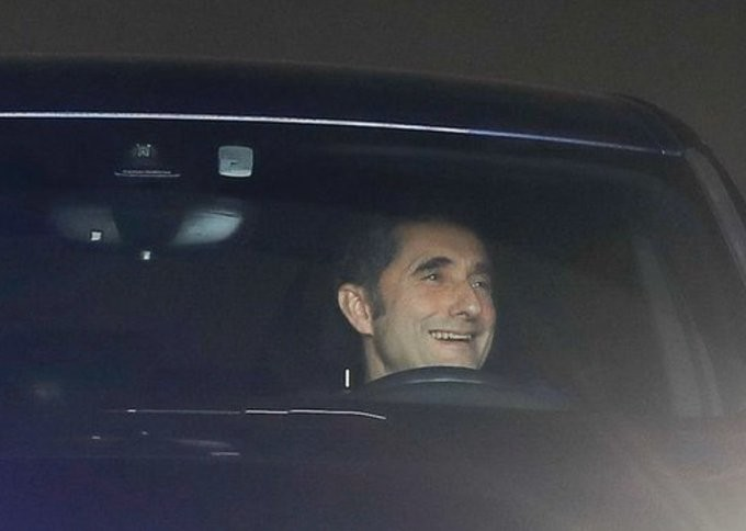 Valverde looks happy after being pictured leaving Barca training ground