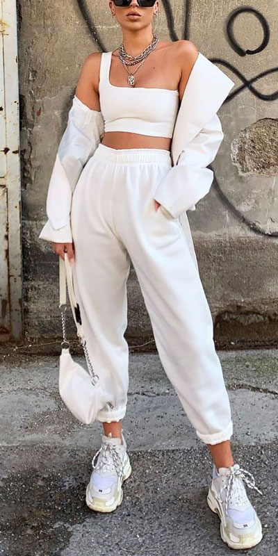 21 Fashion Forward Funky Outfits to Keep You Warm. And make you the coolest, most exciting fashionista on the scene. Winter Outfits via higiggle.com | white jacket + joggers | #fashion #falloutfits #jacket #joggers