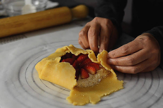 enclosing pastry over strawberries