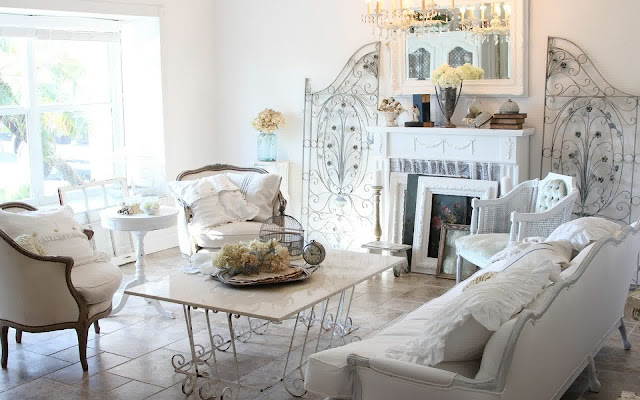 attractive shabby chic living room with vintage granite coffee table and white french sofa