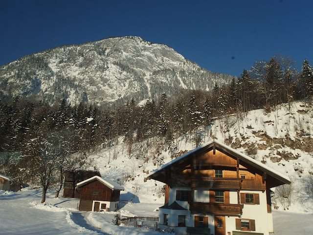 Snowy mountains and traditional Tyrolean buildings as seen from the coach in Kufstein
