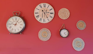 different clocks on red wall