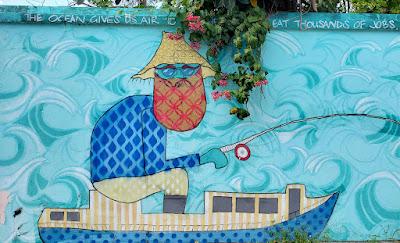 Wall mural of fisherman in boat