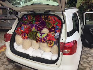 Raju's car packed full of supplies for people in need