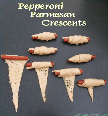Pepperoni Parmesan Crescents are a quick snack for an afternoon with a book, or just as easily served as an appetizer. | Recipe developed by www.BakingInATornado.com | #recipe #snack
