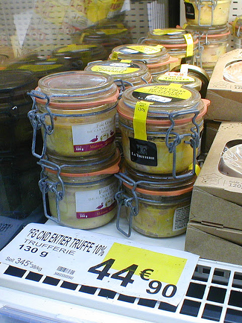 Jars of foie gras with truffle bits in a supermarket, France. Photo by Loire Valley Time Travel.