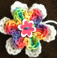 http://www.ravelry.com/patterns/library/layered-button-flower-accent
