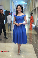 Actress Ritu Varma Pos in Blue Short Dress at Keshava Telugu Movie Audio Launch .COM 0048.jpg