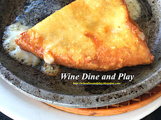 The saganaki starter dish of cooked cheese hit with alcohol then lit on fire for an Opa experience at Costas Greek restaurant in Tarpon Springs, Florida