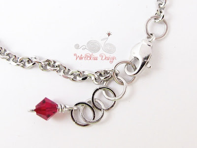 Close up of Minlet Charm and Clasp of Wire Wrapped Minlet (Minima Bracelet) with 4mm Ruby Swarovski crystal