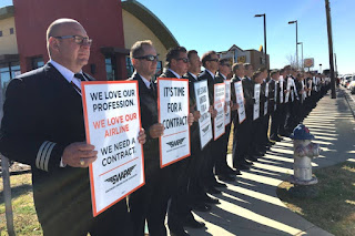 Southwest Airlines pilots walk the picket line in Dallas