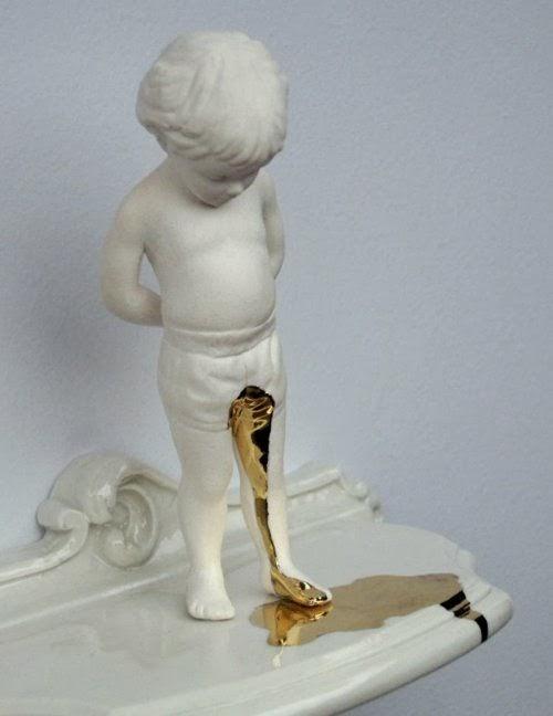 escultura niño