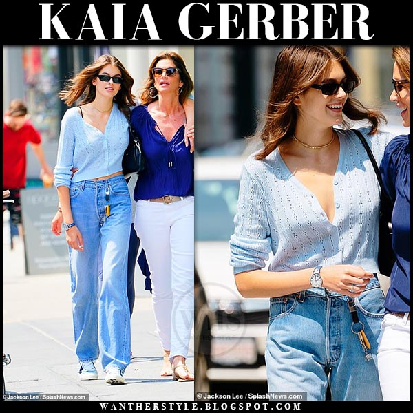c0c456bc0b0b Kaia Gerber in light blue knit cardigan and high rise 90s jeans. Model off  duty