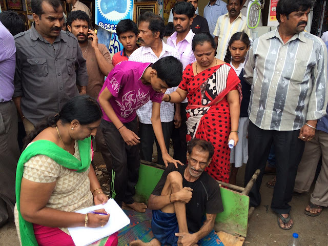 NBF volunteers talking to demolition victims at Doddabommasandra