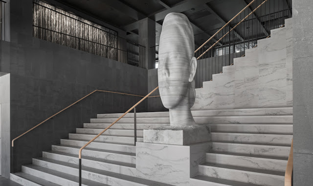 Magnificent marble sculpture on steps in Six Hotel in Stockholm, Mar Whispering by Jaume Plensa