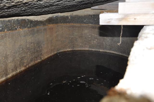 The liquid inside the sarcophagus