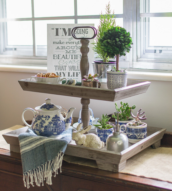 wood tiered tray with blue and white decor