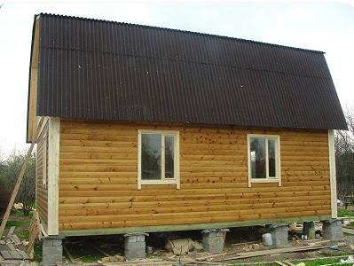 Дом из бруса на столбчатом фундаменте фото