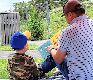 Man reads to boy