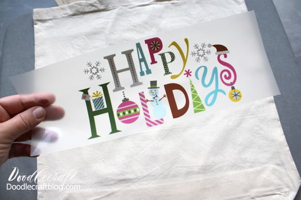 Tote bag ready to be pressed with the Happy Holidays Iron On Design Tote for Christmas in July!