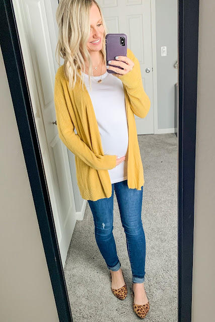 Maternity outfit with a yellow cardigan and leopard shoes
