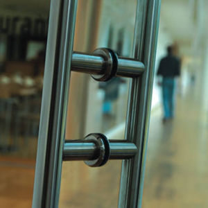 Glass partition with sliding system