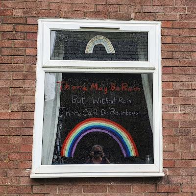 Rain in Manchester rainbow window