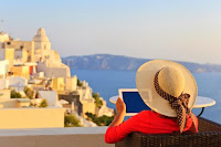 woman using ipad on vacation