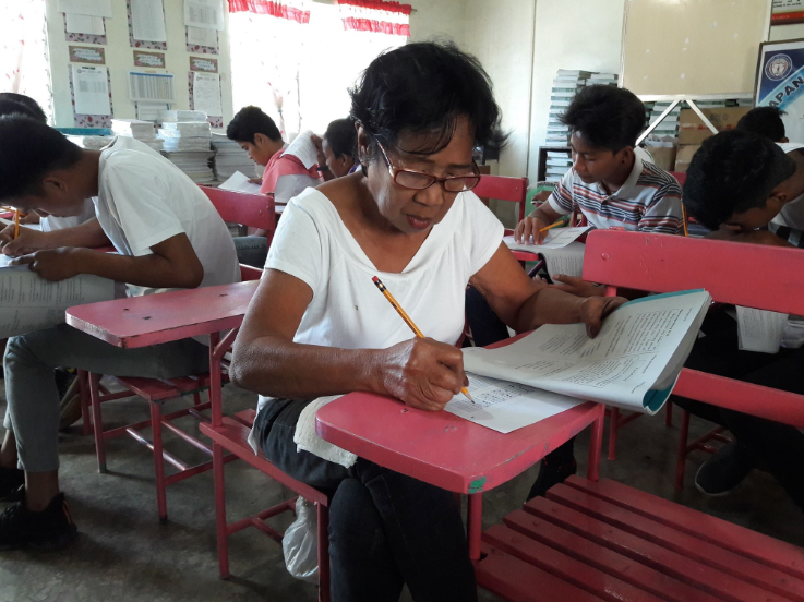 65-year-old woman completes elementary education