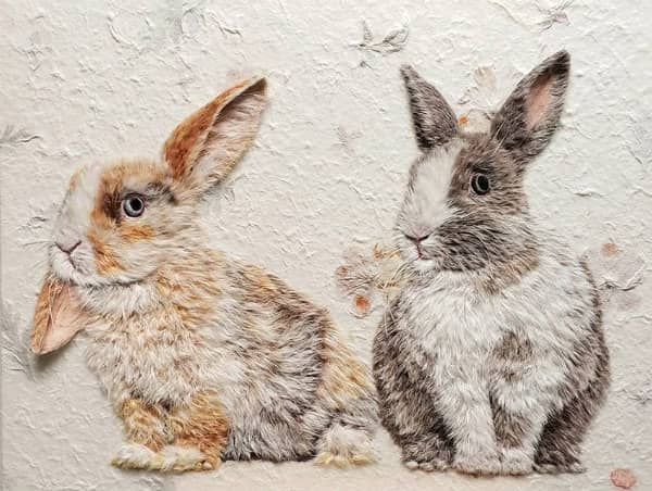 pair of rabbits made of paper fibers