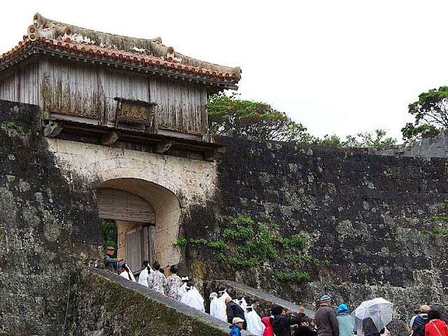 worshipers entering castle via stone stairs