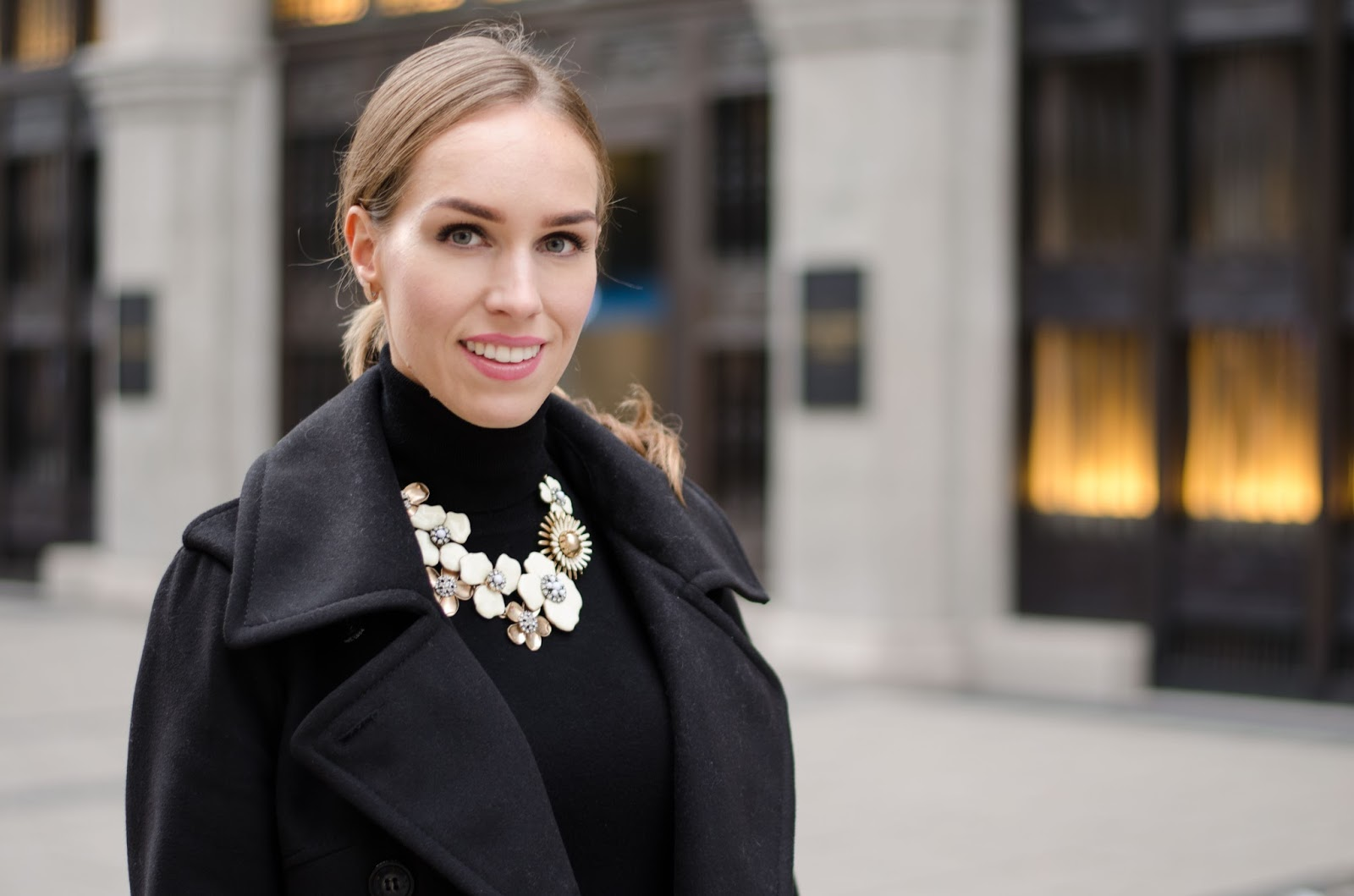 kristjaana mere black pea coat black turtlenect jumper gold white happiness boutique statement necklace
