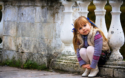 cute-girlbaby-sitting-on-the-rock