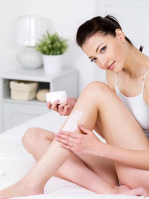 beautiful-woman-applying-body-moisturizing-lotion-cream-her-attractive-legs