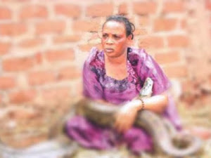 A woman breastfeeding a snake with witch craft