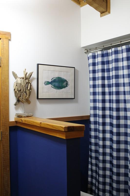 Jack and Jill Bathroom with White And Navy Walls and Gyotaku fish print