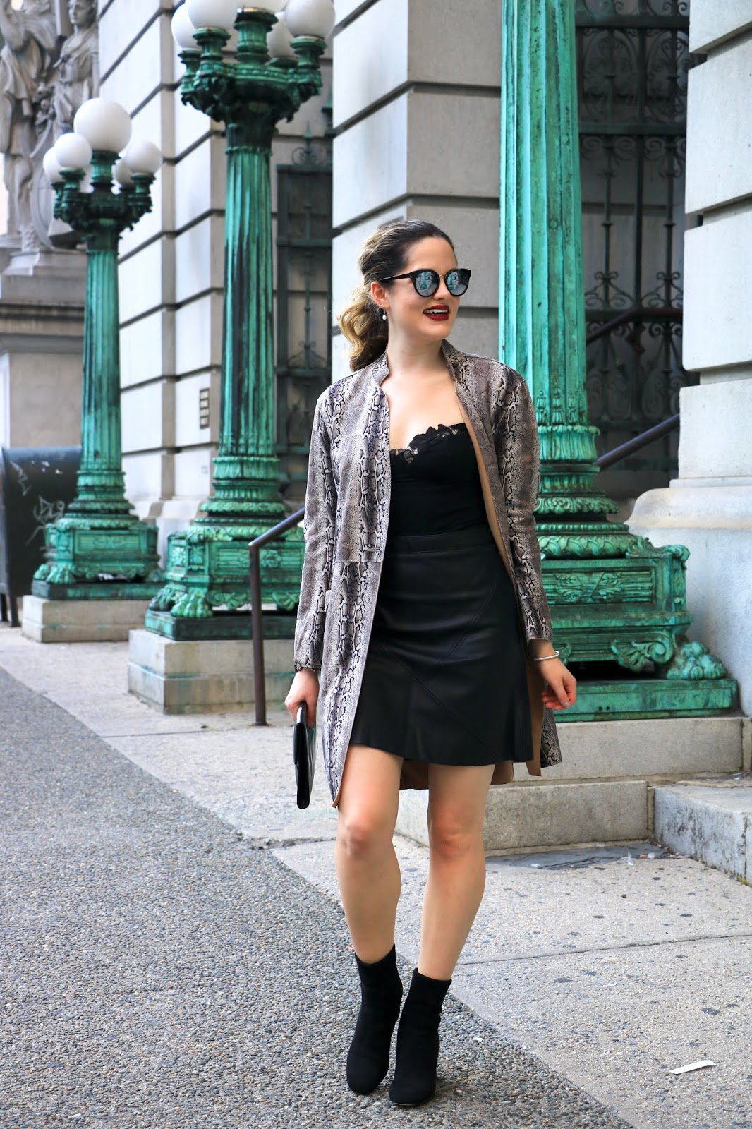 Nyc fashion blogger Kathleen Harper wearing a python print outfit.