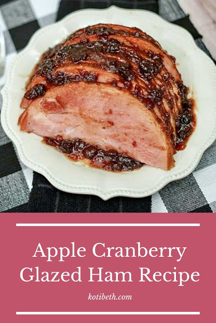 How to make a delicious apple cranberry glazed ham recipe.  This simple recipe has cranberry sauce, brown sugar, apple cider, and cinnamon. Use a bone in spiral cut ham for best results. This can be baked in oven or in roaster. This makes great meals for Christmas or Thanksgiving or just for dinner. Make a simple and quick baked glazed ham for the best meal. #glazed #ham #apple #cranberry