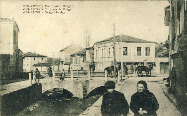 """Solunska"" street with Kurdeles river and the Stone Bridge. French soldiers on horses on the Main Street in 1917."