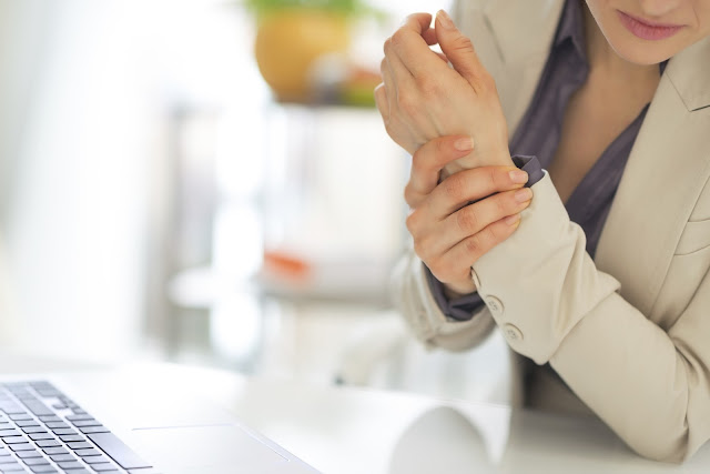 A woman suffering from sore wrist joints may have arthritis.