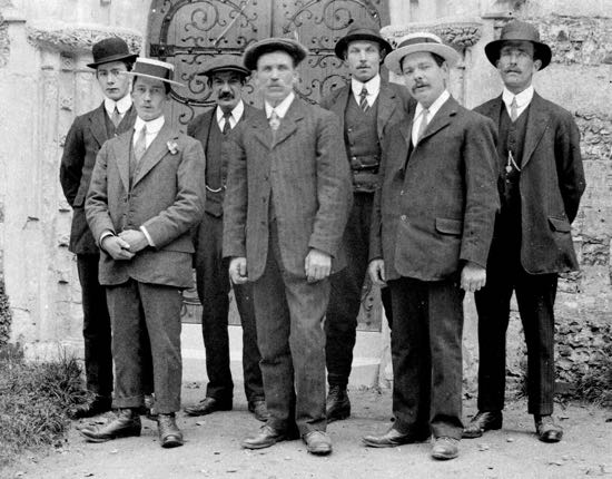 L-R: J Dell, A. Groom, J. Massey, J. Day, R. Perry, G. Spencer, G. Nash Picture taken at the dedication of the West Door given in memory of George Robert Gaussen 1913 Image courtesy of Mill Green Museum, part of the Images of North Mymms Collection