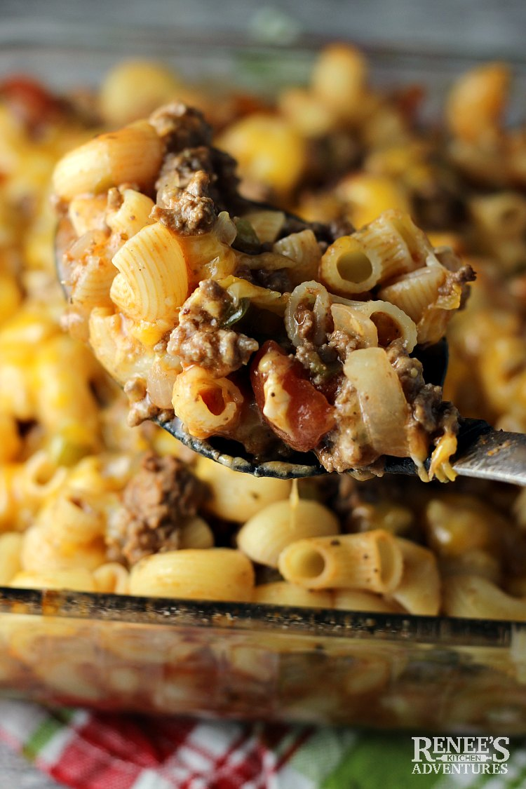 Closeup of spoonful of Johnny Marzetti by Renee's Kitchen Adventures over the pan